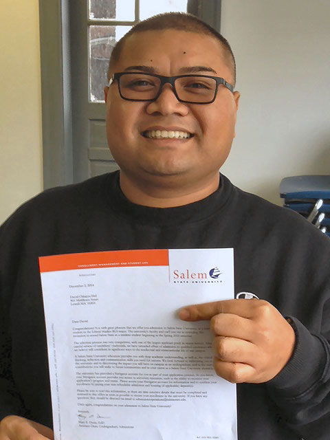 David Hol holding a certificate